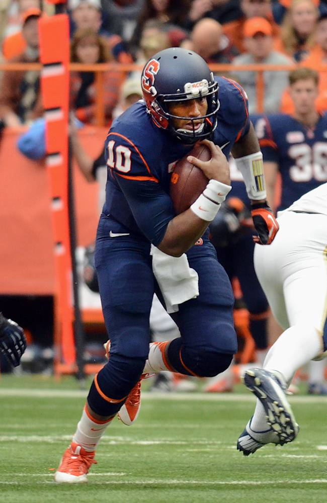 Syracuse's Terrell Hunt (10)  makes a run past Pittsburgh's Bryan Murphy, left, during the first half of an NCAA college football game game at the Carrier Dome in Syracuse, N.Y., Saturday, Nov. 23, 2013