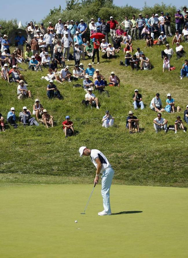 Martin Kaymer of Germany lines up his putt during the first day of the French Open Golf tournament at Paris National course in Guyancourt, west of Paris, France, Thursday, July 3, 2014