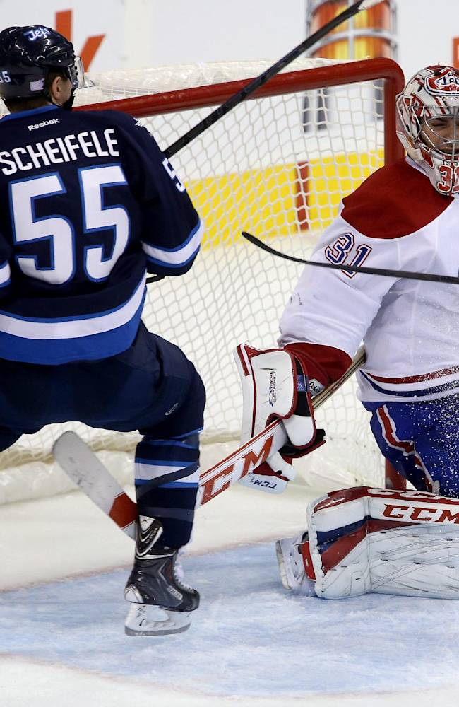 Montreal Canadiens' goaltender Carey Price (31) stops a shot by Winnipeg Jets' Mark Scheifele (55) during the third period of an NHL hockey game in Winnipeg, Manitoba, Tuesday, Oct. 15, 2013. The Canadiens won 3-0