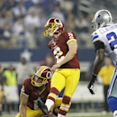 Washington Redskins kicker Kai Forbath (2) and punter Sav Rocca (6) watch Forbath's field goal as Dallas Cowboys cornerback Morris Claiborne, right, pressures in the final seconds of the first half of an NFL football game, Sunday, Oct. 13, 2013, in Arling