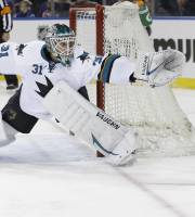 San Jose Sharks goalie Antti Niemi (31), of Finland, reaches for a puck shot on goal during the second period of an NHL hockey game against the New York Rangers, Sunday, March 16, 2014, in New York. The Sharks won the game 1-0. (AP Photo/Frank Franklin II)