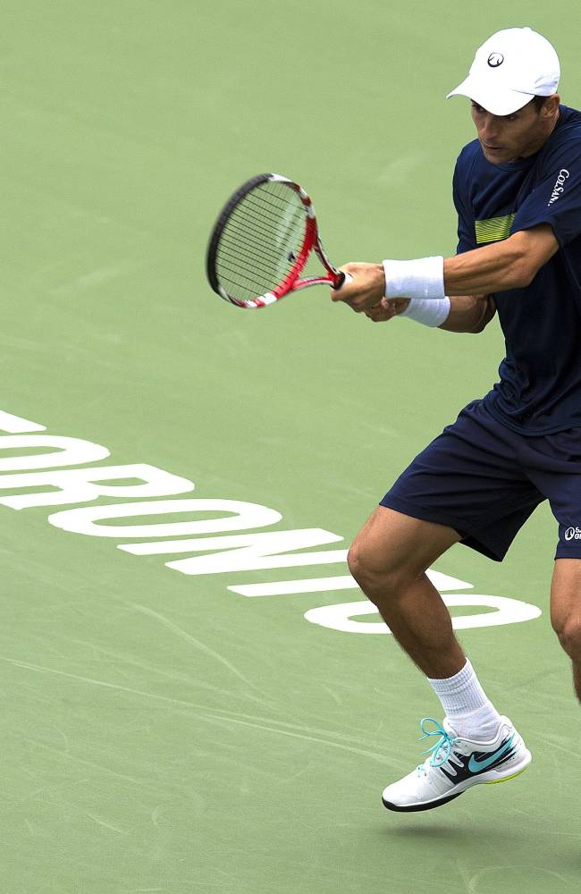 Federer, Sock advance at Rogers Cup