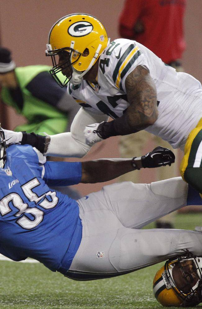 Detroit Lions running back Joique Bell (35) stretches for yardage as he is defended by Green Bay Packers strong safety Morgan Burnett (42) during the fourth quarter of an NFL football game at Ford Field in Detroit, Thursday, Nov. 28, 2013