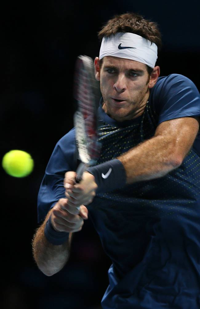 Juan Martin Del Potro of Argentina plays a return to Roger Federer of Switzerland during their ATP World Tour Finals tennis match at the O2 Arena in London, Saturday, Nov. 9, 2013