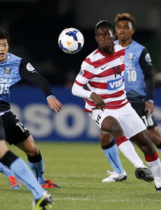 Western Sydney Wanderers' Kwabena Appiah, right, controls the ball against Kawasaki Frontale during their group stage soccer match of the AFC Champions League in Kawasaki, near Tokyo, Tuesday, April 1, 2014