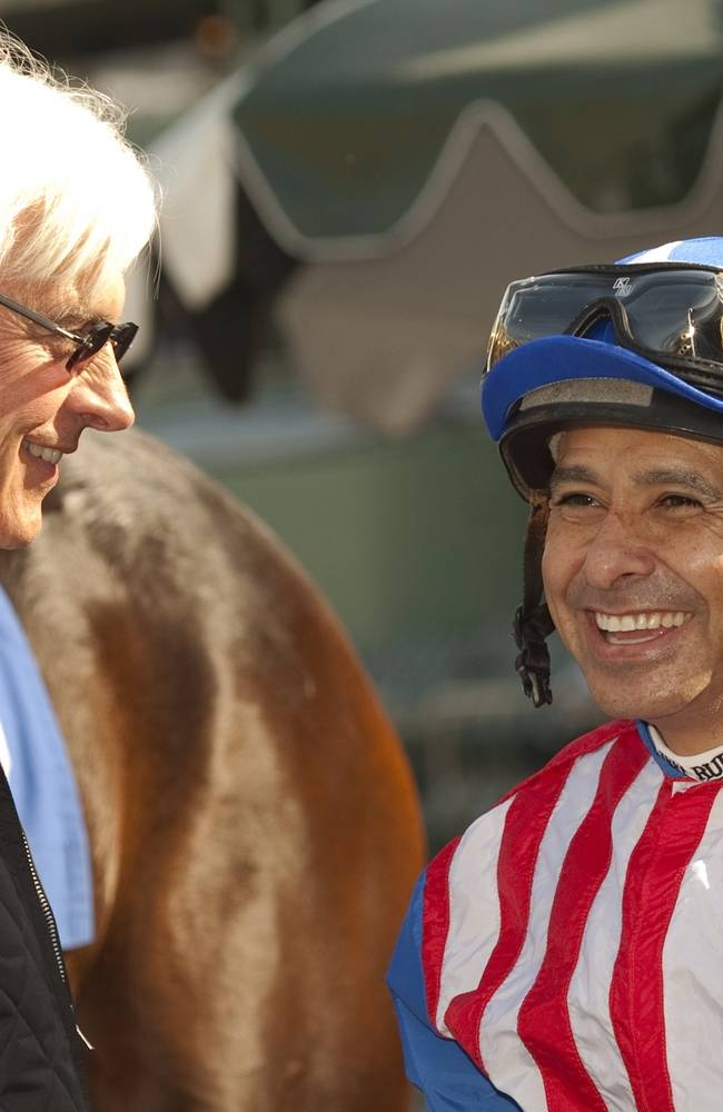 In this image provided by Benoit Photo, trainer Bob Baffert, left, and jockey Mike Smith enjoy  Awesome Baby's victory in the Grade II Santa Ynez Stakes horse race on Saturday, Jan. 4, 2014, at Santa Anita Park in Arcadia, Calif