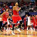 WASHINGTON, DC - DECEMBER 23: Derrick Rose #1 of the Chicago Bulls celebrates after making a shot in the second half of the Bulls 99-91 win over the Washington Wizards at Verizon Center on December 23, 2014 in Washington, DC. (Photo by Rob Carr/Getty Images)
