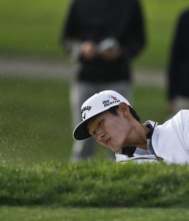 Danny Lee, from New Zealand, hits from the bunker on the sixth hole of the South Course at Torrey Pines where he made par during the first round of the Farmers Insurance Open golf tournament Thursday, Jan. 23, 2014, in San Diego