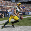 Green Bay Packers wide receiver Jordy Nelson (87) gets up to celebrate after a touchdown reception against the Chicago Bears in the first half of an NFL football game Sunday, Sept. 28, 2014, in Chicago. The Associated Press
