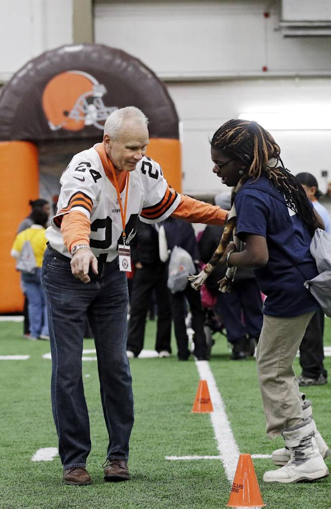 Former NFL defensive back Ernie Kellerman works with area Special Olympians at the Cleveland Browns Play 60 football festival  at their practice facility in Berea, Ohio Thursday, Feb. 13, 2014. Kellerman, a Cleveland native, played eight years in the NFL between 1966 and 1973 for the Browns, Cincinnati Bengals and Buffalo Bills