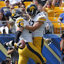 Iowa tight end Henry Krieger Coble, left, celebrates with Iowa linebacker John Kenny (47) after catching a pass in the endzone for a first-quarter touchdown during an NCAA college football game against Pittsburgh in Pittsburgh Saturday, Sept. 20, 2014 The