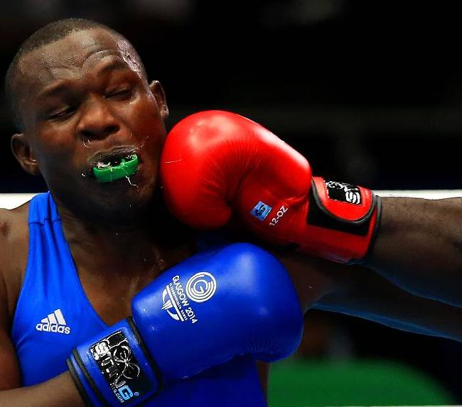 Ugandan Mike Sekabembe competes with Ghana's Haruna Osumanu, not pictured, in the men's Super Heavy Weight +91Kg weight at the SECC, during the 2014 Commonwealth Games in Glasgow, Scotland, Tuesday, July 29, 2014