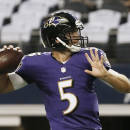 Baltimore Ravens quarterback Joe Flacco (5) warms up before an NFL preseason football game against the Dallas Cowboys, Saturday, Aug. 16, 2014, in Arlington, Texas. (AP Photo/Brandon Wade)