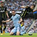 Manchester City's Frank Lampard, center, is brought down for a penalty by Tottenham Hotspur's Erik Lamela during the English Premier soccer match between Manchester City and Tottenham Hotspur at the Etihad Stadium, Manchester, England, Saturday Oct. 18, 2