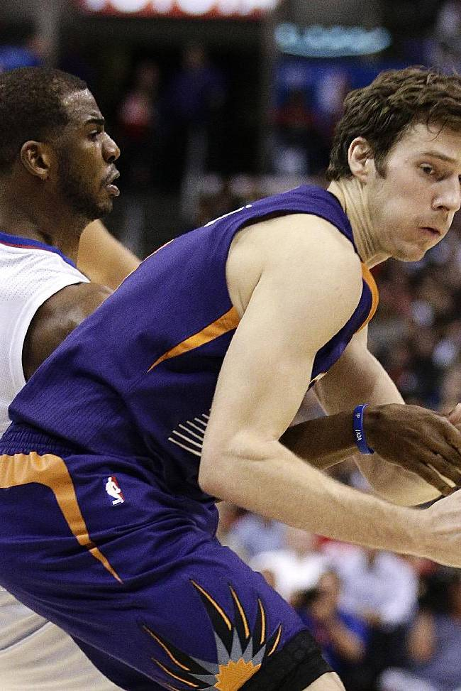 Los Angeles Clippers' Chris Paul, left, defends Phoenix Suns' Goran Dragic, of Slovenia, during the second half of an NBA basketball game on Monday, Dec. 30, 2013, in Los Angeles