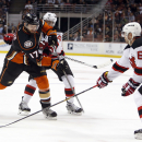 Anaheim Ducks' Ryan Kesler (17) is double-teamed by New Jersey Devils' Adam Henrique and Andy Greene (6) during the second period of an NHL hockey game Friday, Jan. 16, 2015, in Anaheim, Calif The Associated Press