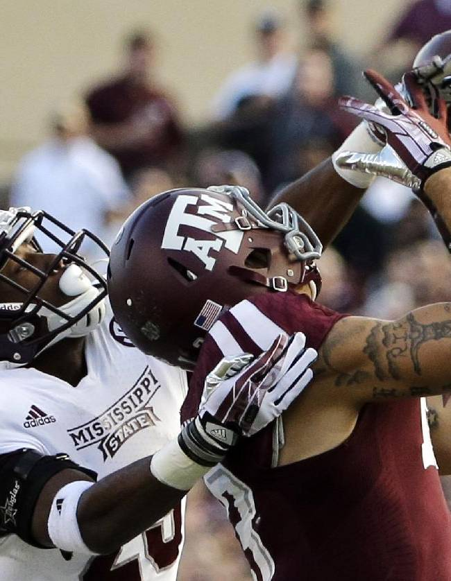 Mississippi State defensive back Taveze Calhoun (23) breaks up a pass intended for Texas A&M wide receiver Mike Evans (13) during the second quarter of an NCAA college football game Saturday, Nov. 9, 2013, in College Station, Texas