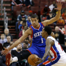 Philadelphia 76ers' Michael Carter-Williams (1) tries to block a pass by Detroit Pistons' Brandon Jennings (7) during the first half of an NBA basketball game on Saturday, March 29, 2014, in Philadelphia The Associated Press
