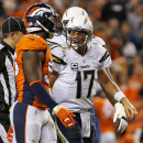 San Diego Chargers quarterback Philip Rivers (17) yells at Denver Broncos outside linebacker Von Miller during the second half of an NFL football game, Thursday, Oct. 23, 2014, in Denver. The Broncos won 35-21 The Associated Press