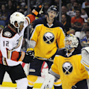 Anaheim Ducks right winger Devante Smith-Pelly, left, celebrates a goal by William Karlsson as Buffalo Sabres defenseman Tyler Myers, center, and goaltender Michal Neuvirth, right, react during the second period of an NHL game against the Monday, Oct., 1