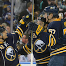 Buffalo Sabres' Tyler Ennis (63) skates in to celebrate with Zemgus Girgensons (28) and Tyler Myers (57) after Myers scored during the third period of an NHL hockey game Saturday, Nov. 15, 2014, in Buffalo, N.Y. Buffalo won 6-2 The Associated Press