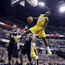 Indiana Pacers guard Lance Stephenson (1) reacts after a slam dunk over San Antonio Spurs guard Danny Green (4) and forward Tim Duncan (21) in the first half of an NBA basketball game in Indianapolis, Monday, March 31, 2014 The Associated Press