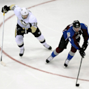Pittsburgh Penguins left wing James Neal, left, pursues Colorado Avalanche defenseman Tyson Barrie during the first period of an NHL hockey game Sunday, April 6, 2014, in Denver The Associated Press