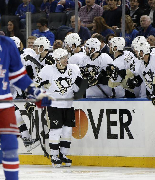 Teammates congratulate Pittsburgh Penguins center Sidney Crosby (87) who scored his first goal of the playoffs in the second period of a second-round NHL Stanley Cup hockey playoff game against the New York Rangers at Madison Square Garden in New York, Monday, May 5, 2014.  The Penguins shut out the Rangers 2-0 to take a 2-1 lead in the series