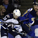 Winnipeg Jets' Tobias Enstrom, of Sweden, and St. Louis Blues' Alex Pietrangelo, right, chase after a loose puck along the boards during the second period of an NHL hockey game Monday, March 17, 2014, in St. Louis The Associated Press