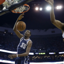 Oklahoma City Thunder forward Kevin Durant (35) slam dunks as New Orleans Pelicans forward Tyreke Evans (1) watches in the first half of an NBA basketball game in New Orleans, Monday, April 14, 2014 The Associated Press