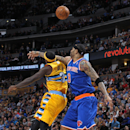 Denver Nuggets guard Ty Lawson, left, collides with New York Knicks forward Kenyon Martin while trying to pull in a loose ball in the first quarter of an NBA basketball game in Denver, Friday, Nov. 29, 2013 The Associated Press