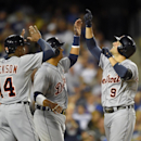 Detroit Tigers' Nick Castellanos, right, is congratulated by teammates Austin Jackson, left, and Victor Martinez after hitting a three-run home run during the third inning of a baseball game against the Los Angeles Dodgers, Wednesday, April 9, 2014, in Lo