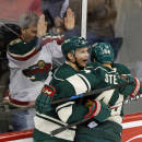 Minnesota Wild's Mikko Koivu, front left, of Finland, and Chris Stewart, right, celebrate Koivu's goal against Los Angeles Kings goalie Jonathan Quick in the first period of an NHL hockey game, Saturday, March 28, 2015, in St. Paul, Minn. (AP Photo/Jim Mone)