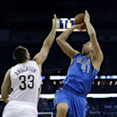 Dallas Mavericks power forward Dirk Nowitzki (41) shoots over New Orleans Pelicans power forward Ryan Anderson (33) in the first half of an NBA basketball game in New Orleans, Wednesday, Dec. 4, 2013 The Associated Press