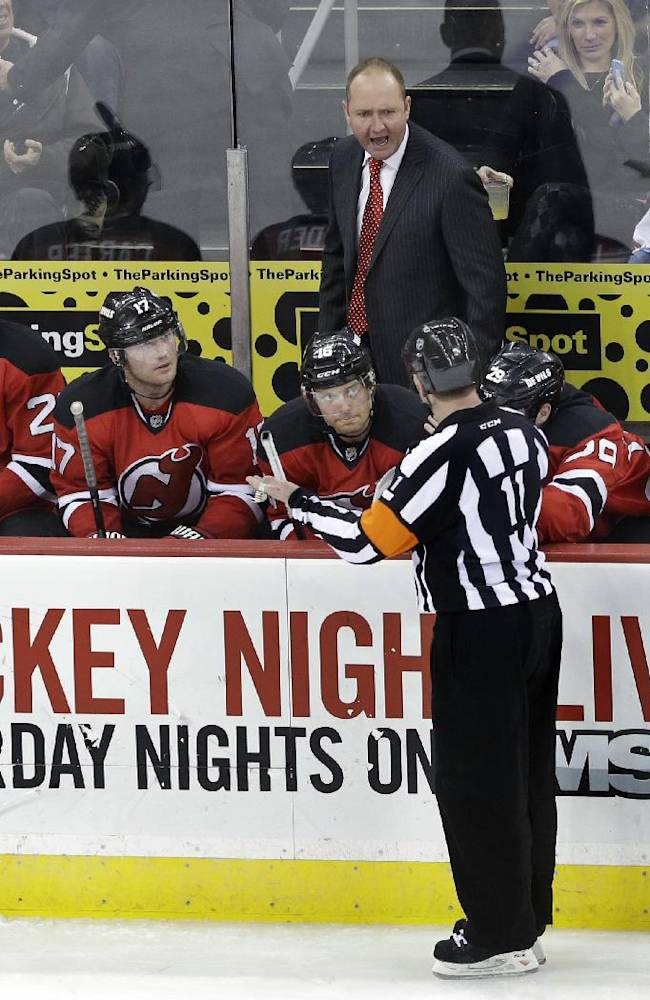New Jersey Devils coach Peter DeBoer shouts at referee Kelly Sutherland (11) during the third period of an NHL hockey game against the New York Rangers on Saturday, March 22, 2014, in Newark, N.J. The Rangers won 2-0