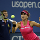 Belinda Bencic, of Switzerland, returns to Jelena Jankovic, of Serbia, during their match in the fourth round of the 2014 U.S. Open tennis tournament, Sunday, Aug. 31, 2014, in New York. (AP Photo/Elise Amendola)
