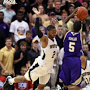 Wofford's Karl Cochran (2) tries to block the shot of Western Carolina's Trey Sumler (5) during the first half of the NCAA college basketball championship game of the Southern Conference tournament in Asheville, N.C., Monday, March 10, 2014. (AP Photo/Adam Jennings)