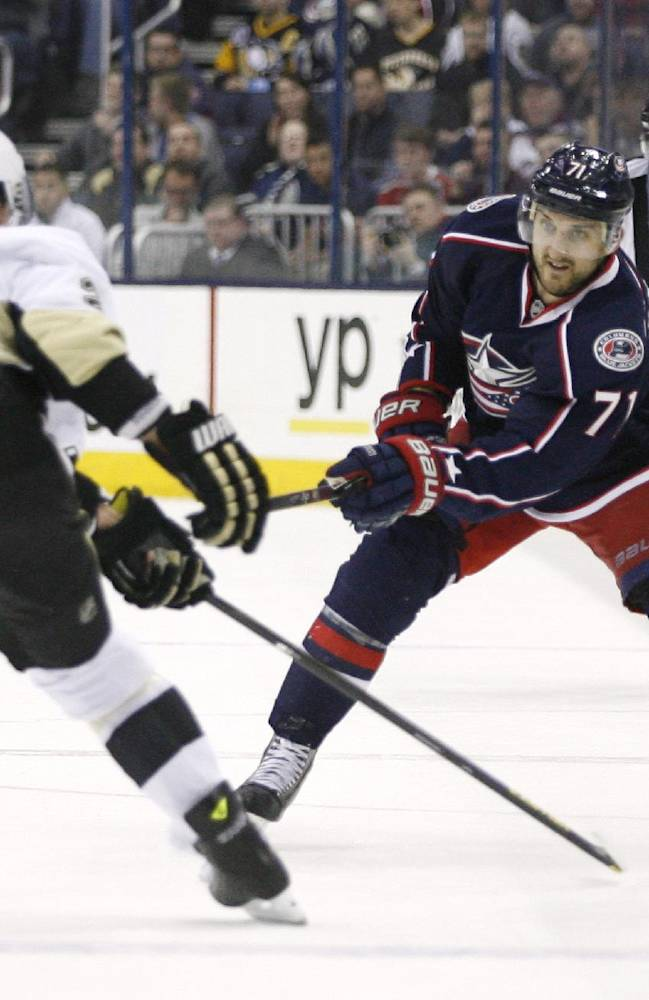 Columbus Blue Jackets' Nick Foligno (71) shoots past Pittsburgh Penguins' Matt Niskanen (2) during the second period of an NHL hockey game, Friday, March 28, 2014, in Columbus, Ohio