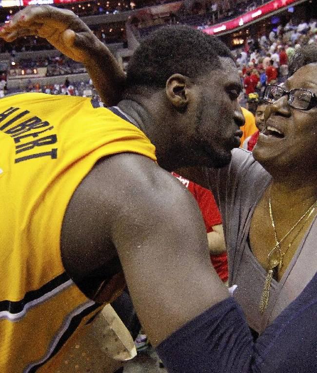 Indiana Pacers center Roy Hibbert (55) kisses his mother Patricia Hibbert after Game 4 of an Eastern Conference semifinal NBA basketball playoff game in Washington, Sunday, May 11, 2014. The Pacers won 95-92