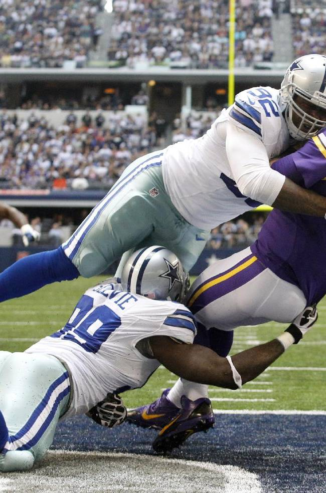 In this Nov. 3, 2013 file photo, Dallas Cowboys' George Selvie (99) and Jarius Wynn (92) combine to  tackle Minnesota Vikings' Christian Ponder (7) who fumbles the ball in the end zone in the second half of an NFL football game, in Arlington, Texas. The Cowboys recovered the ball for a touchdown on the play. The Buffalo Bills have signed free agent defensive lineman Jarius Wynn, who split last season between San Diego and Dallas