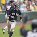 New York Yankees' Ichiro Suzuki comes in to score from first during the fourth inning on an Eduardo Nunez single during a spring exhibition baseball game against the Pittsburgh Pirates in Bradenton, Fla., Thursday, March 27, 2014 The Associated Press