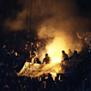 Dinamo fans set fire in the stands during the Group E Europa League match between PSV Eindhoven and Dinamo Moscow at Philips stadium, in Eindhoven, Netherlands, Thursday, Dec. 11, 2014. Dinamo won the match, both teams will go on to play the round of 32 T