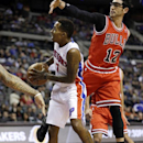 Detroit Pistons guard Brandon Jennings (7) looks around Chicago Bulls guard Kirk Hinrich (12) during the second half of an NBA basketball game in Auburn Hills, Mich., Wednesday, Nov. 27, 2013 The Associated Press