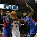 Detroit Pistons forward Greg Monroe (10), center Andre Drummond (0) and Atlanta Hawks forward Paul Millsap (4) fight for the ball during the first period of an NBA basketball game in Atlanta, Tuesday, April 8, 2014. The Pistons won the game 102-95 The Ass