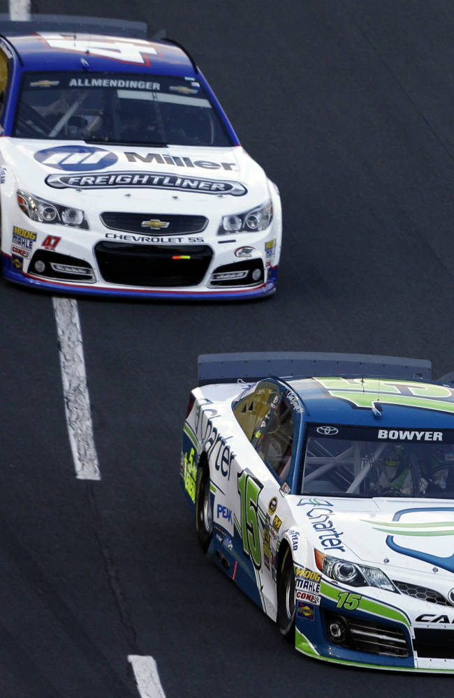 Clint Bowyer (15) leads AJ Allmendinger (47) along the front stretch during the NASCAR Sprint Showdown auto race at the Charlotte Motor Speedway in Concord, N.C., Friday, May 16, 2014. Bowyer won the segment to advance to the All-Star race on Saturday
