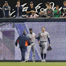 Detroit Tigers' right fielder Don Kelly, right, is helped by Austin Jackson after crashing into the fence trying to catch a ball hit by San Diego Padres' Jedd Gyorko during the first inning of a baseball game Friday, April 11, 2014, in San Diego. Kelly co