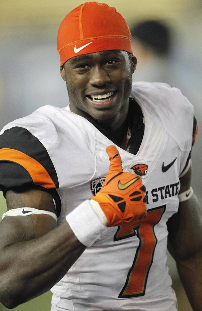 Oregon State wide receiver Brandin Cooks (7) gives a thumbs up to Oregon State fans from the sidelines during the final seconds against California in a NCAA college football game in Berkeley, Calif., Saturday, Oct. 19, 2013. Oregon State won 49-17