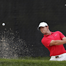 Rory McIlroy, of Northern Ireland, hits from a bunker on the 13th hole during the first round of play at The Barclays golf tournament Thursday, Aug. 21, 2014, in Paramus, N.J. (AP Photo/Mel Evans)