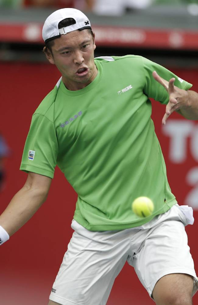 Tatsuma Ito of Japan returns the ball against Feliciano Lopez of Spain during their first round match at the Japan Open Tennis Championships in Tokyo, Tuesday, Oct. 1, 2013. Lopez won 4-6, 7-5, 6-3