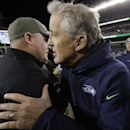 Seattle Seahawks head coach Pete Carroll, right, and Philadelphia Eagles head coach Chip Kelly meet after an NFL football game, Sunday, Dec. 7, 2014, in Philadelphia. Seattle won 24-14 The Associated Press